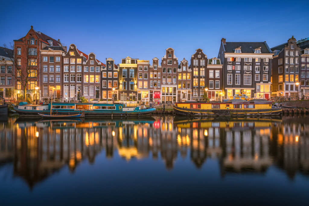 Blue hour long exposure capture of the classic spot of the Amsterdam Canal District