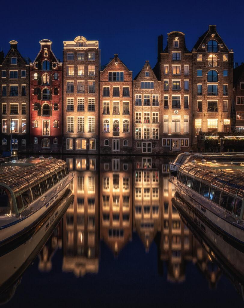 Golden light on the Amsterdam Damrak Canal Houses