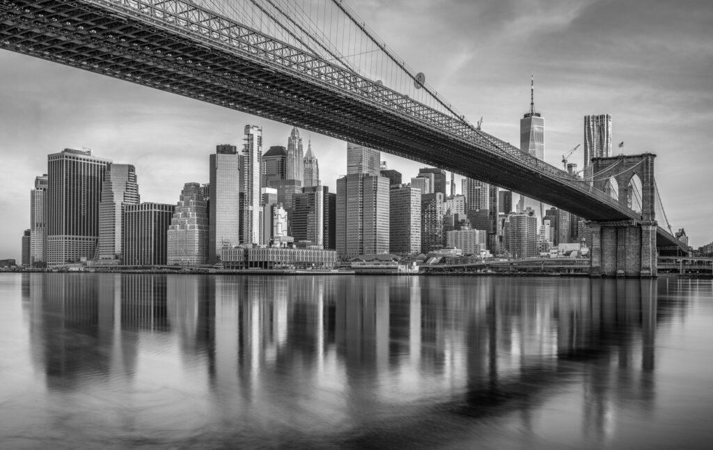 Monochrome capture of the Manhattan skyline and the Brooklyn Bridge